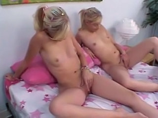 Skinny blonde teen twins masturbate together