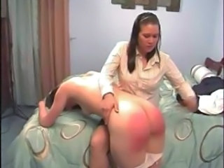 Girl gets a firm hand spanking by her stepmother