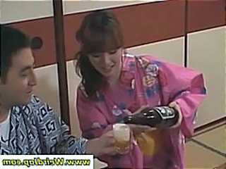 Naughty Japanese geisha serves and then shows some of her skin