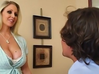 Horny blonde huge rack milf Julia Ann titfucks her sons tutor