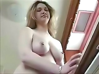 Busty blonde gets naked to clean up the kitchen and shows it all
