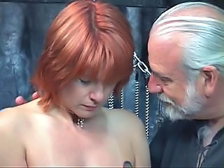 Mature redheaded slave with saggy tits is whipped in hippy',s basement
