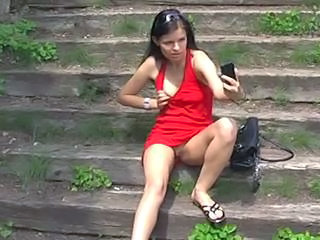 Red dressed girl in a public park . Sex Tubes