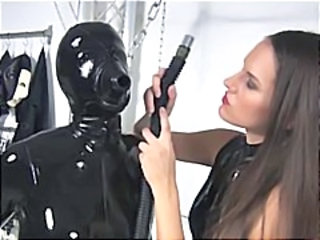 Nasty lesbian covered in black latex suit and mask must breath her mistresses pussy fumes