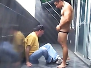 Stra8 Latino bodybuilder is a hustler I paid for on vacation. I give him a blowjob on the balcony.