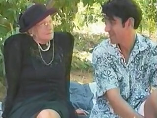 GRANNY AWARD 5 blonde  mature with a young man outdoor