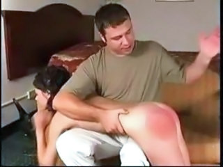 Danielle gets naked and spanked while laying on dude's lap