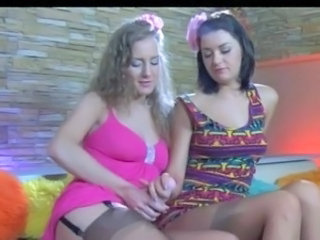 Dolled-up sapphic nymphs lick glossy tan nylons and put to use the large strapon