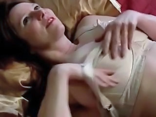 Mature with big tits and hairy pussy masturbates with toy