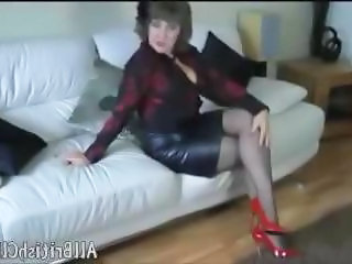 British Matured Pulchritude In Leather Skirt And Patent Red Heels british euro brit european cumshots swallow