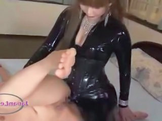 Slave Girl In Mask Getting Her Pussy Fucked With Strapon By Mistress On The Bed In The Roo