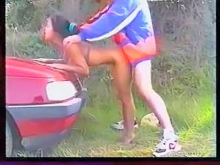 Asian hot babe fucking on a peugeot car hood