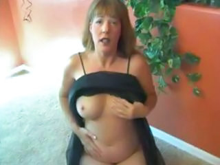 busty older  brunette lady afton wears a watch