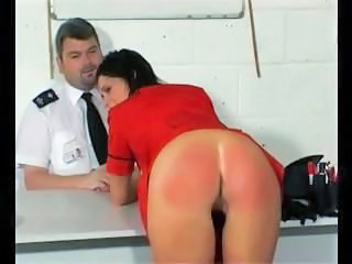 Young skinny brunette gets her ass bright red from spanking received from security personnel