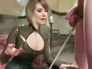 Perverted lady with sexy tits and outfitted in leather whipping s