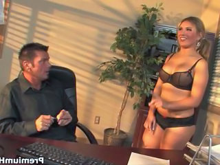 Busty secretary in sexy outfit working out her boss cock on the desc