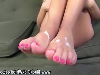 Interracial fetish slut gives a footjob ending with a cumshot