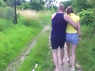Couple chick touches cock inside A park