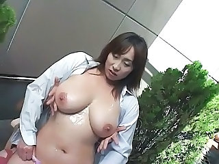 Massages her big boobs with lotion