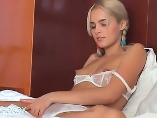 Tempting Sasha in lingerie massaging her pussy with oil