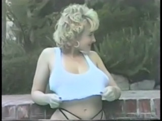 Danni Ashe In The Pool Showing Her Tits