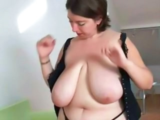Chubby wife with huge tits is stripping and posing on cam