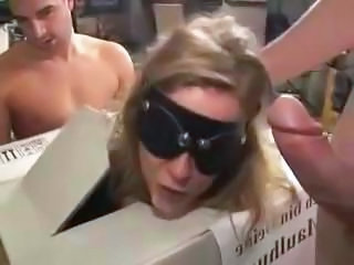 Blonde MILF in a blindfold gets a bunch of cocks to suck and fuck