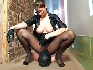 Videos from: sunporno | Busty brunette mistress in black tortures her masked slave