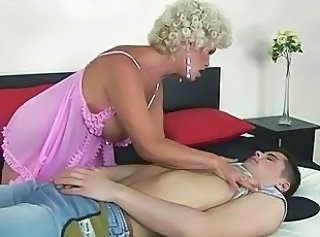 Naughty old bitch fucking a boy