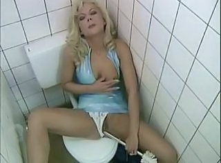 Horny euro-milf fucks stranger in public bathroom