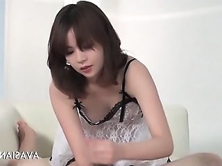 Hot asian girl givers a lovely handjob for cum