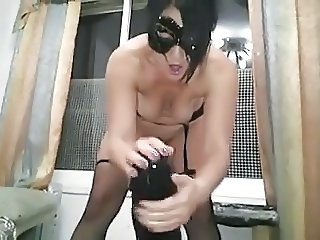 super-sized dildo for masked amateur