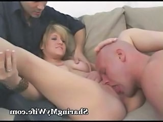 Blonde housewife proves that she is a sex hungry vixen by fucking two guys