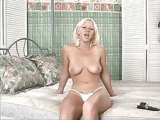 Busty blond in white swimsuit does saleable unparalleled..