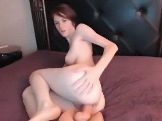 Girl with big boobs rides sex toy