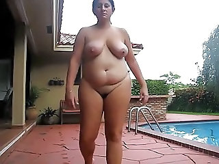 BBW MILF Takes Naked Walk Through Back Yard