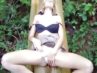 Hot Blonde Masturbates on a log in the forest