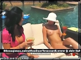 Young brunette girl at the pool gets rubbed with oil