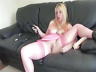 British slut Lucy G plays with herself on a leathersofa