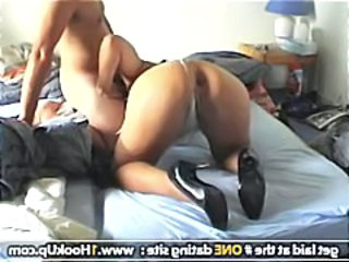 Dude has his wife bend over as he gives her the hard shaft in the ass