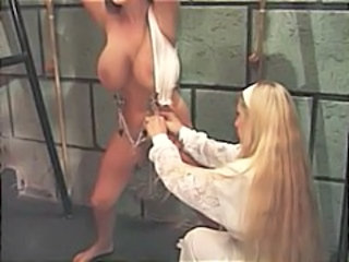 Busty brunette is strung up and tortured by her blonde mistress