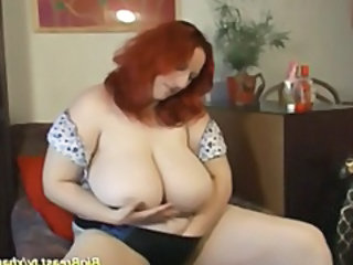 Fat redhead with really big natural tits shows them and toys pussy