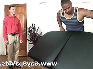 Muscled black dude massages white gay guy