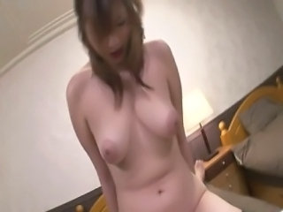 Araki Hitomi is a naughty and cute Asian chick with big pair of knockers and...