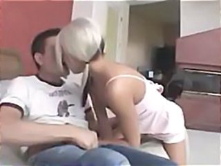 Blonde chick slurps on a cock and takes a phone call while getting drilled