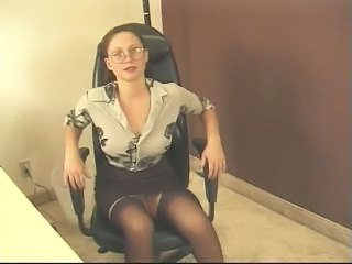Office gal in stockings and specs is...