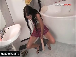 Hot schoolgirl riding huge dildo on the floor