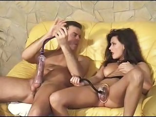 Brunette Enlarges Cock And Pussy Lips Wi...