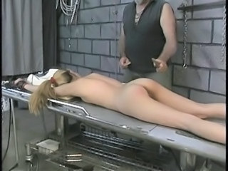 Slut on bondage table gets spanked