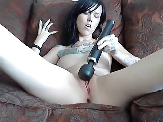 tattooed girl masturbates massager
